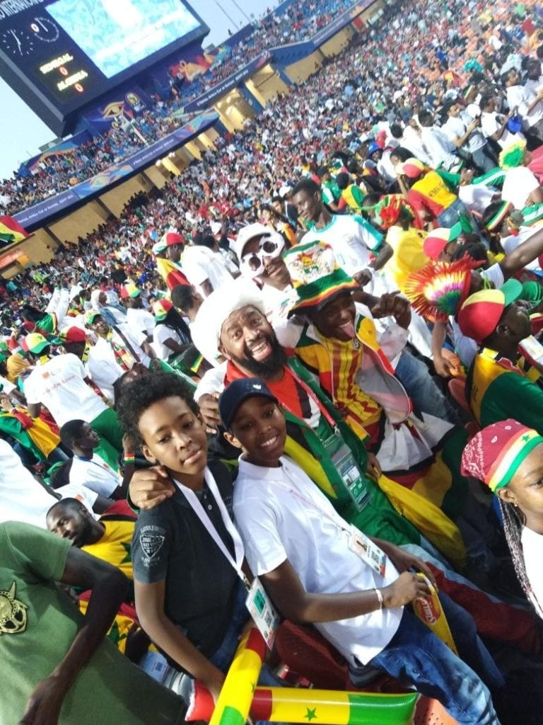 """Afcon """"Superfan"""" Alvin Zhakata with Senegal fans posing for a photo during the final soccer match"""